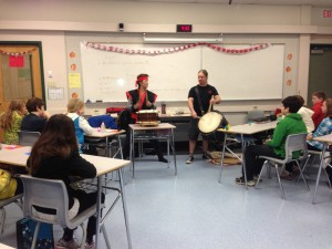 Nobuko Kimura and Jacob Derksen demonstrate taiko at Elementary School. Photo by Lily Yee.