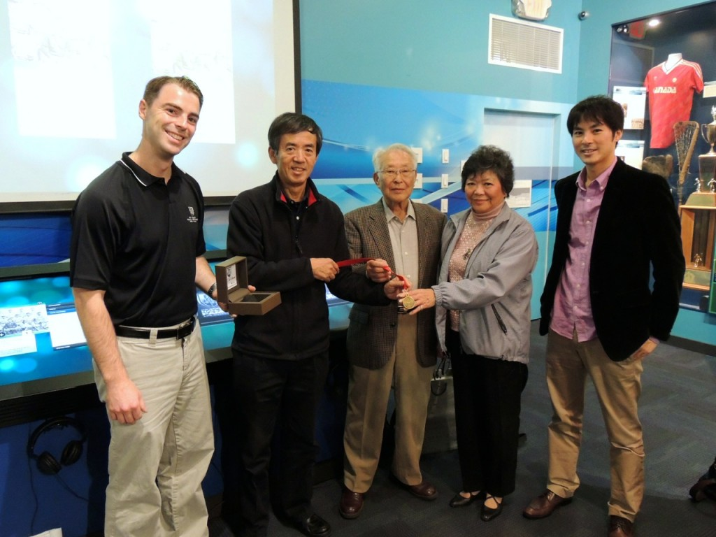 shima family receives medal